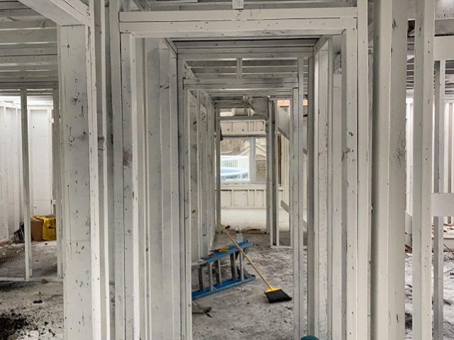 Encapsulating door frames to trap any remaining smoke odors after a fire in Albany